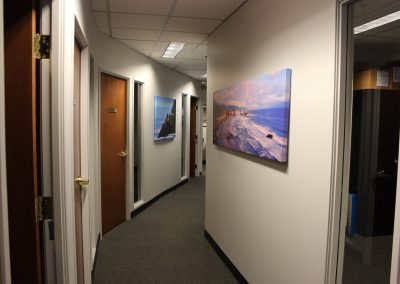 Hallway Image of VA Loan Center with Photo of Military Battle Ship